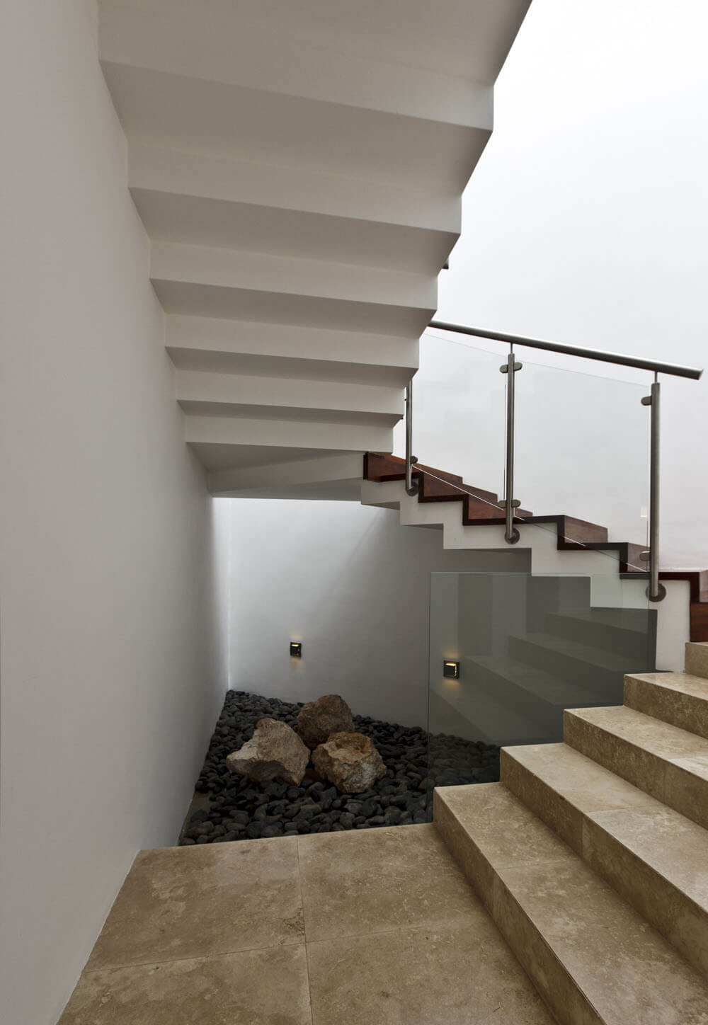 Yucatan cantilevered house rocks under staircase