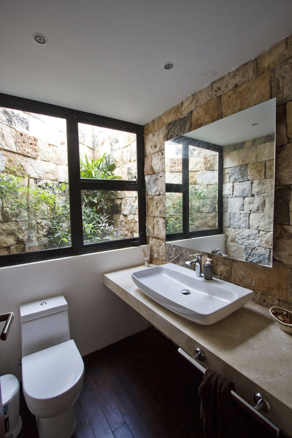 Yucatan cantilevered house stone in bathroom