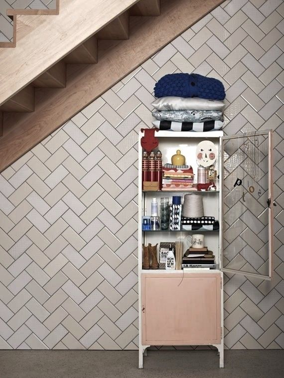 full-wall herringbone subway tile pattern