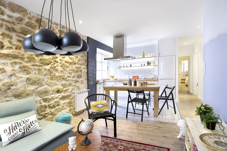 small apartment in Spain dining between kitchen and living area
