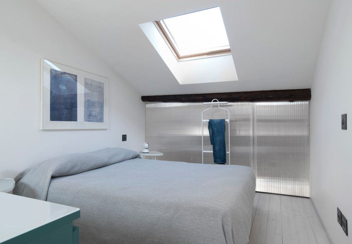 small milan apartment bedroom skylight