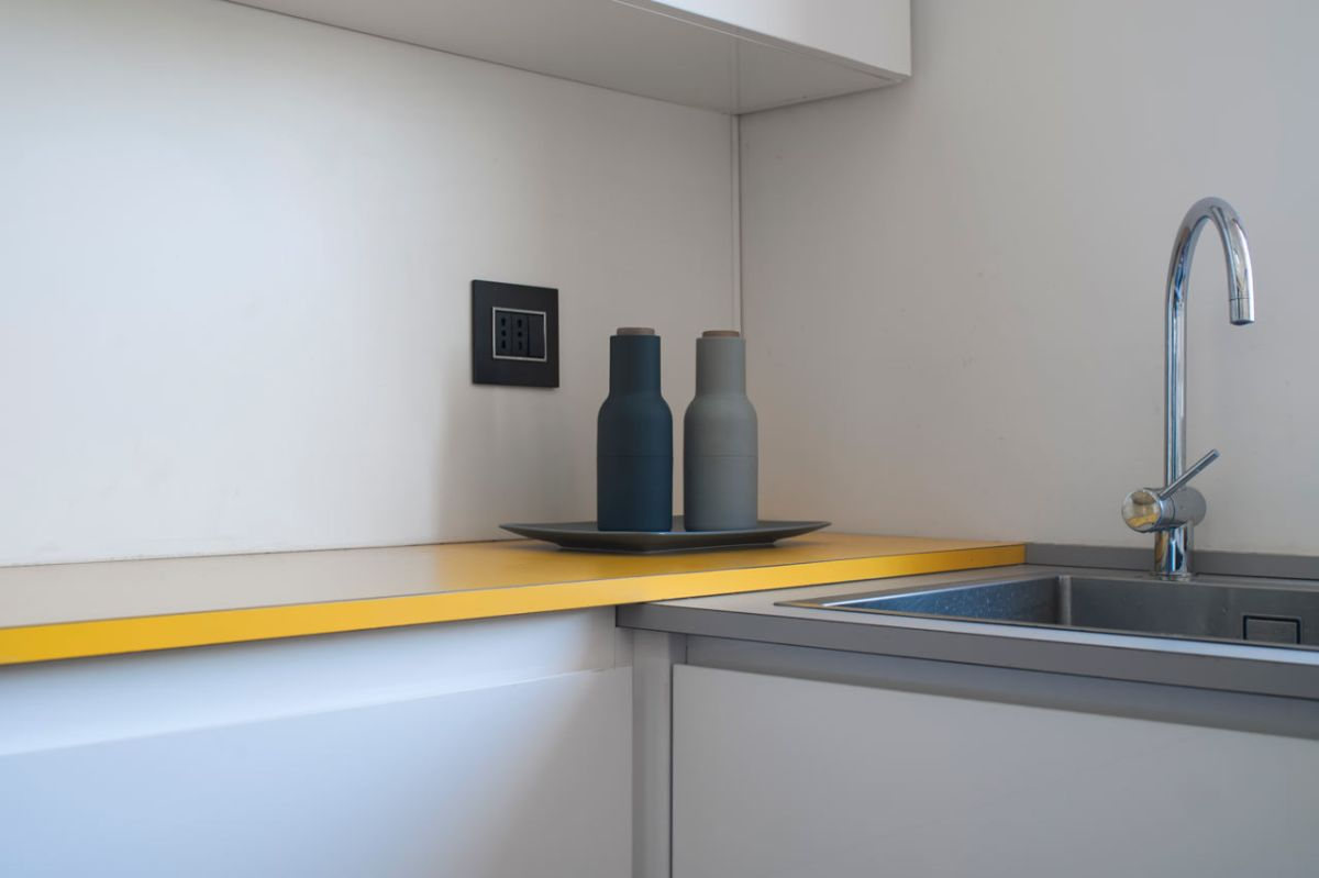 small milan apartment kitchen corner counter colors