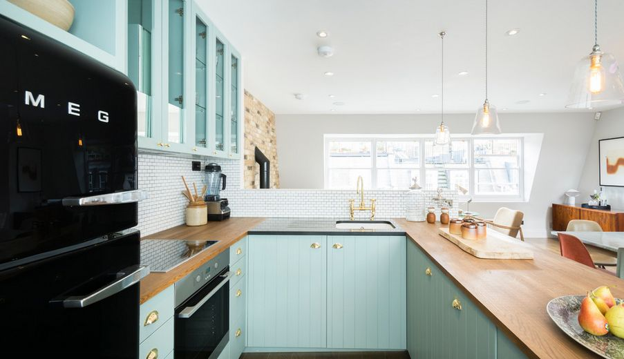 Aqua kitchen design with black SMEG fridge