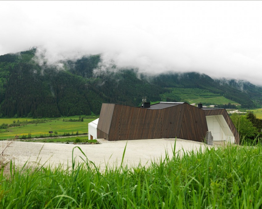 Austrian mountain retreat gables roof mimics mountains