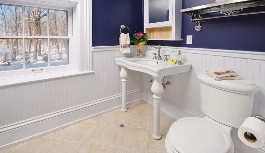Bathroom with half white and indigo walls