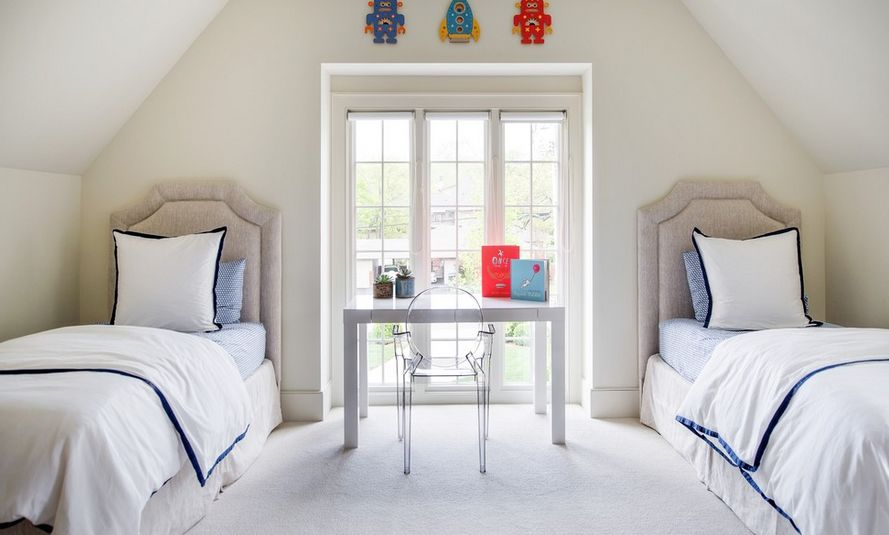 Light and airy, the clear chair in this bedroom does not compete with the view through the beautiful window.