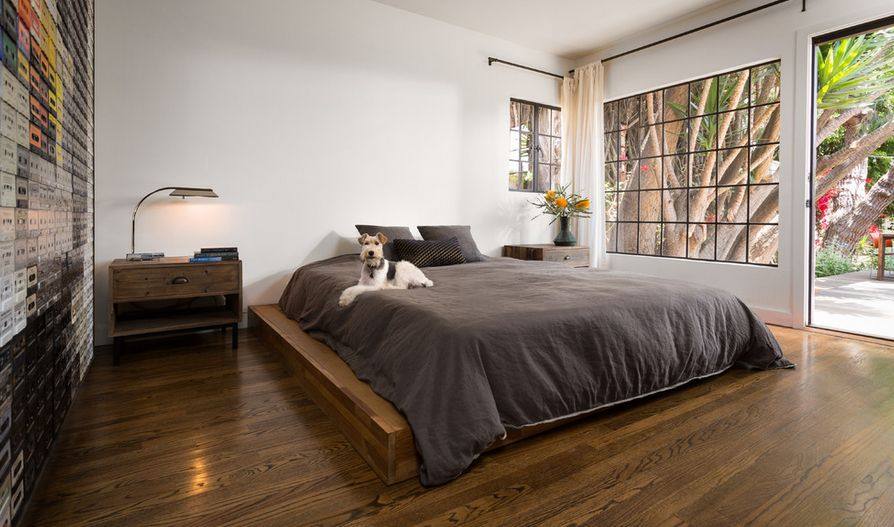 Bedroom With A Platform Bed And Hardwood Floor