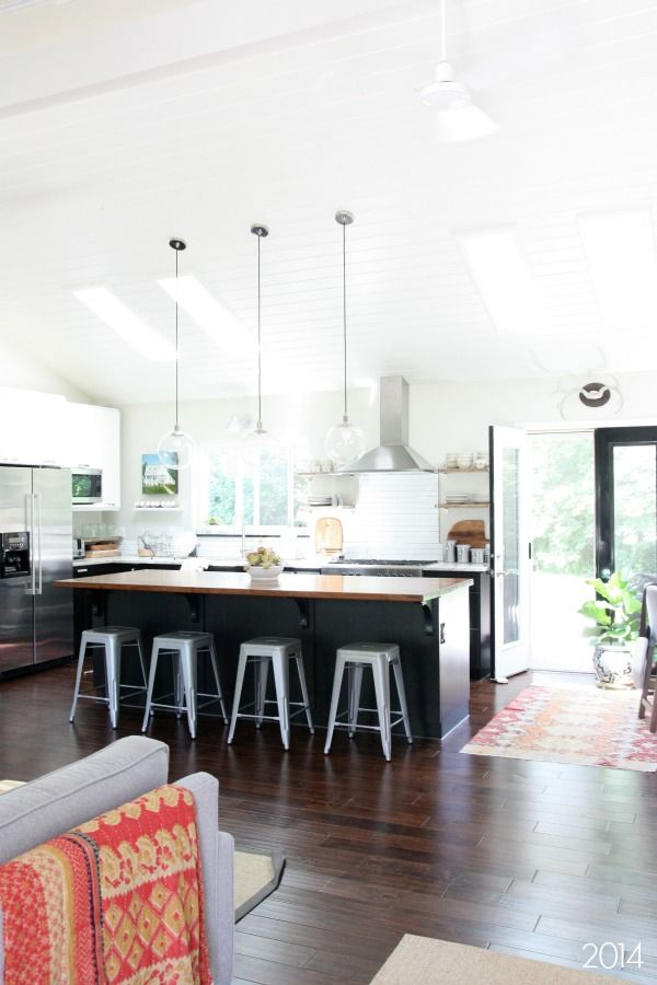 Black and white kitchen design with vaulted ceiling