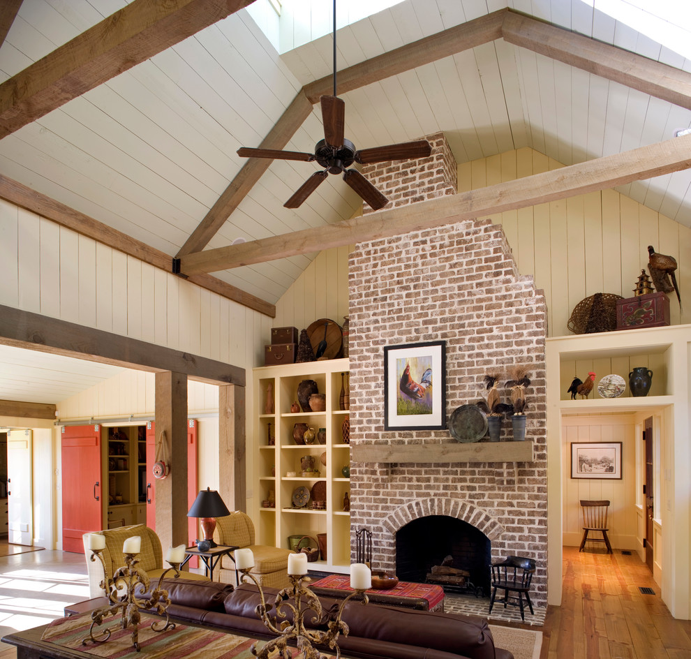 Brick Fireplace house design with high ceilings