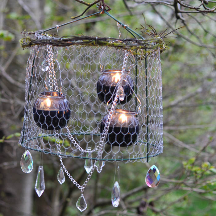 Candles and cage wire to create a chandelier