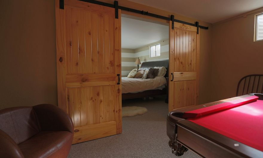 Cozy basement sliding barn door