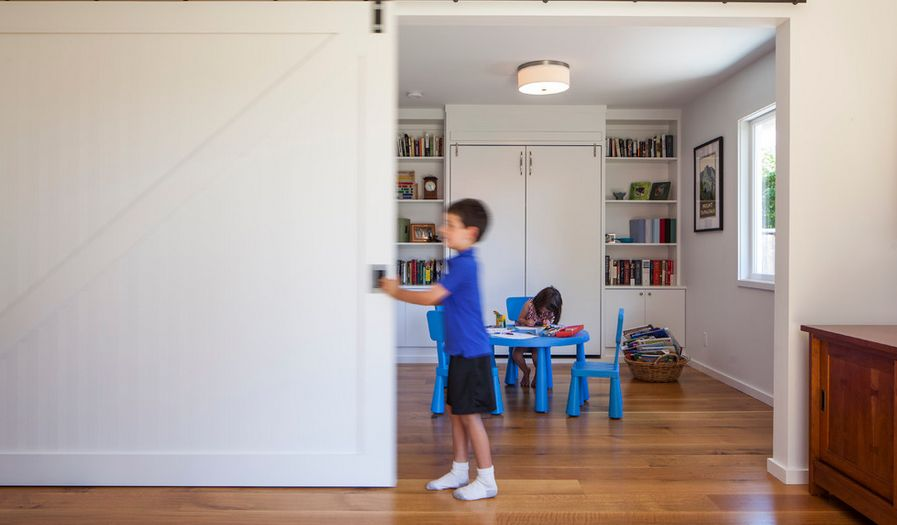 Divide a playroom from living with a sliding barn door