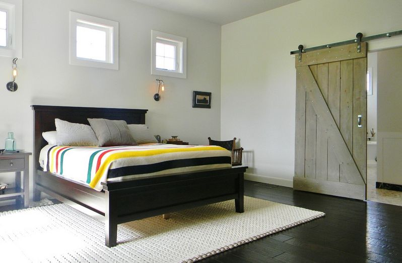 Eclectic interior design with barn door