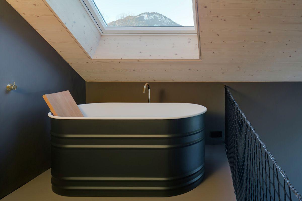 Freestanding tub under a ceiling window