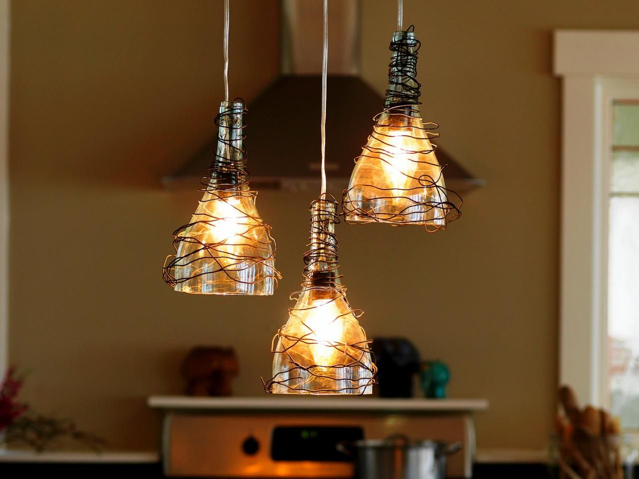 Diy chandeliers that will light up your day how to make a pendant lighting chandelier from glass bottles arubaitofo Images