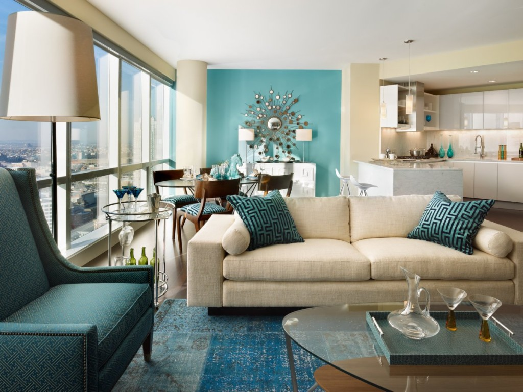 Large living room with aqua wall design