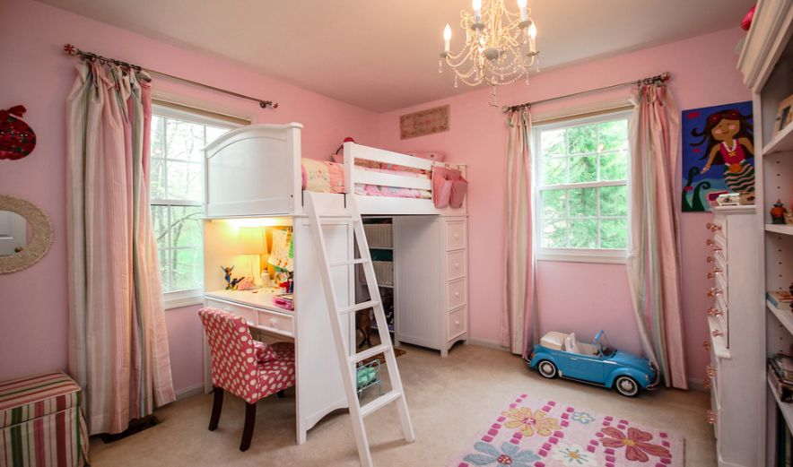 Loft bed for girl room decorated in pink