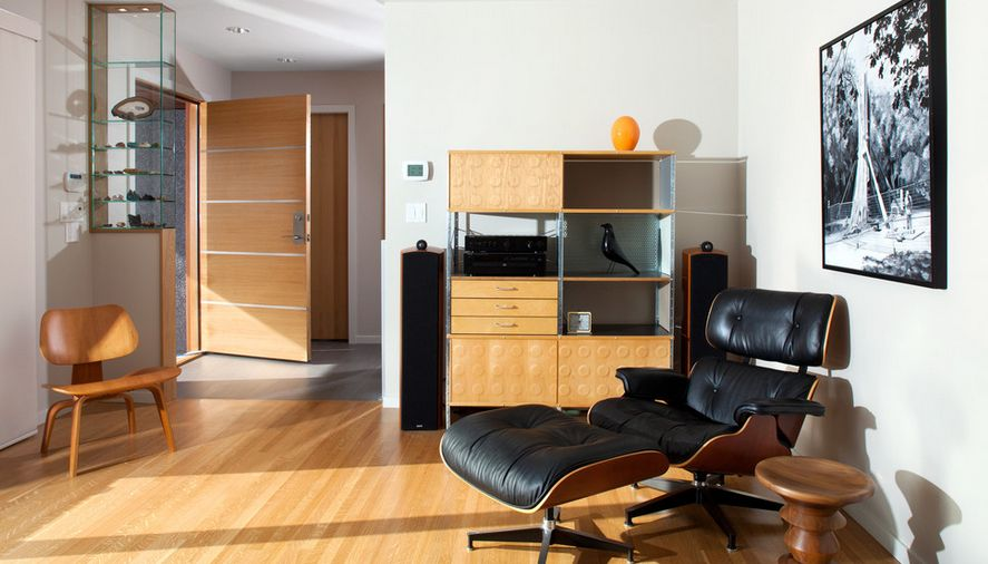 This mid-century living room looks like it was designed with the Eames Lounge Chair in mind.