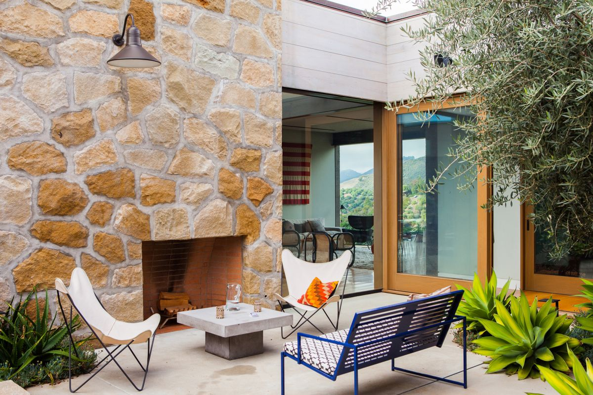 Modern Santa Barbara retreat outdoor fireplace and stone walls