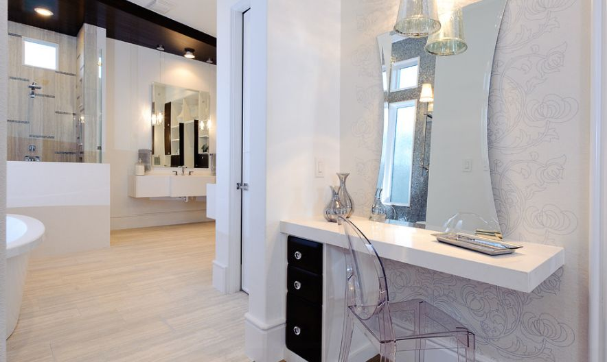 Not just for dining rooms and kitchens, a Ghost chair can elevate any part of your home. In this modern bath vanity area, the chair lets the unusual mirror take center stage.