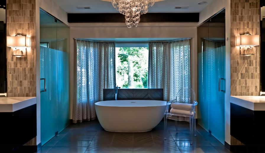 Such a stunning bathroom should not be cluttered with a bulky piece. The Ghost chair provides understated seating as elegant as the rest of the space.
