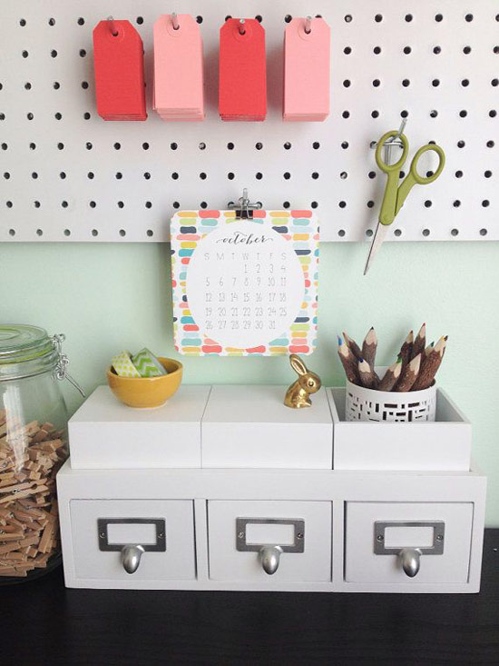 Organized cubicle decor with pegboards