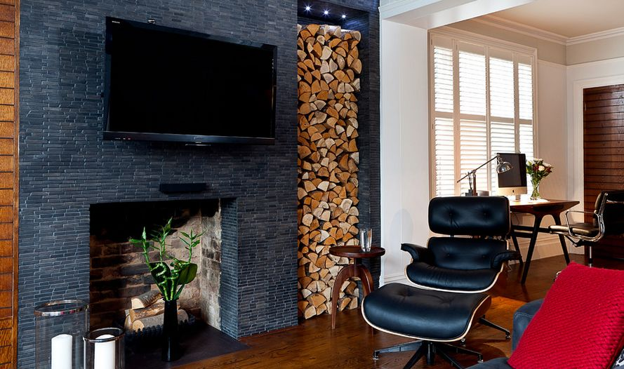 The Eames chair is a sleek counterpoint to the many textures at play in this modern yet cozy living room.