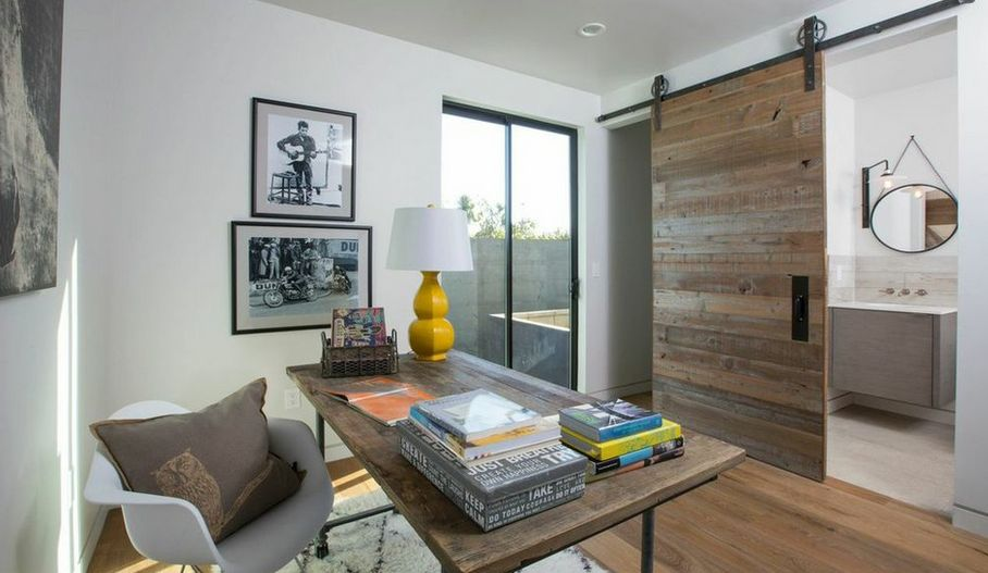 Pipes work table and sliding barn door create an indutrial design
