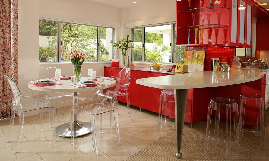 Red kitchen design whit ghost chairs for dining