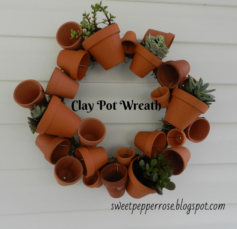 Several tiny terracotta pots into wreath