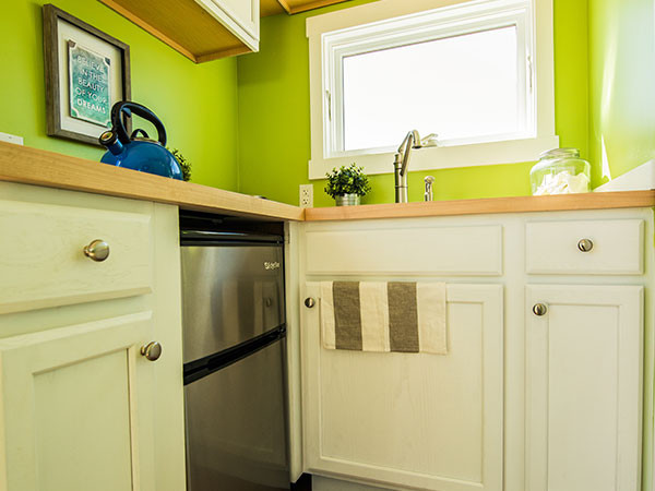 Steel tiny house in wheels kitchen
