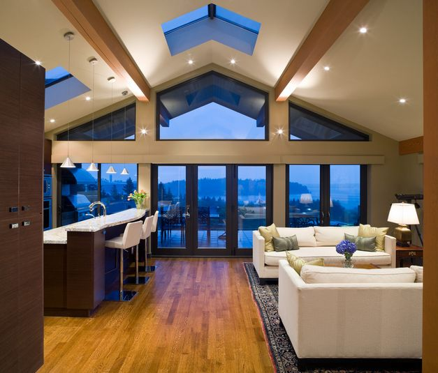 Vaulted ceilings 101 history pros cons and inspirational examples - Expansive large glass windows living room pros cons ...
