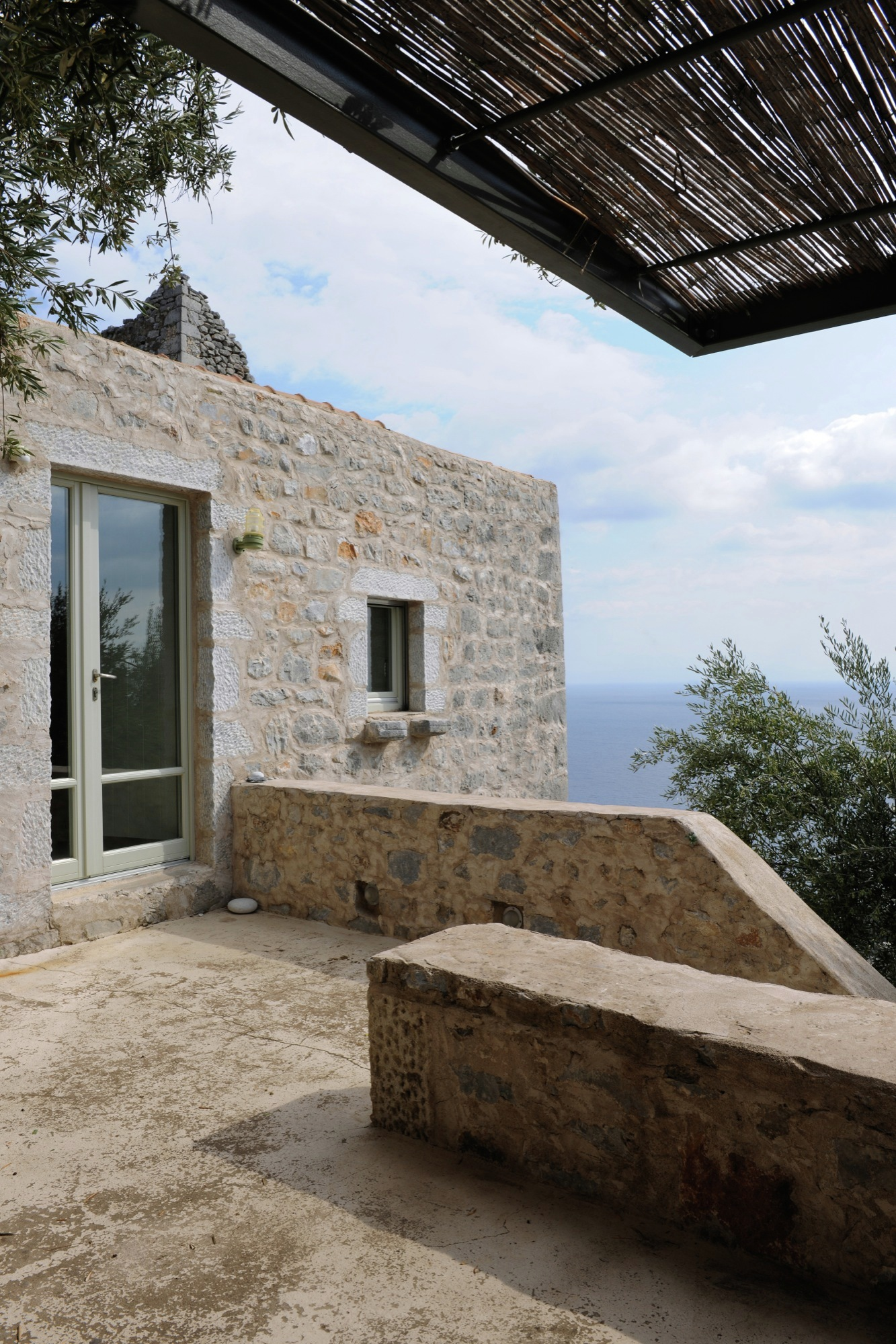 Tower holiday house in Greece exterior stone walls
