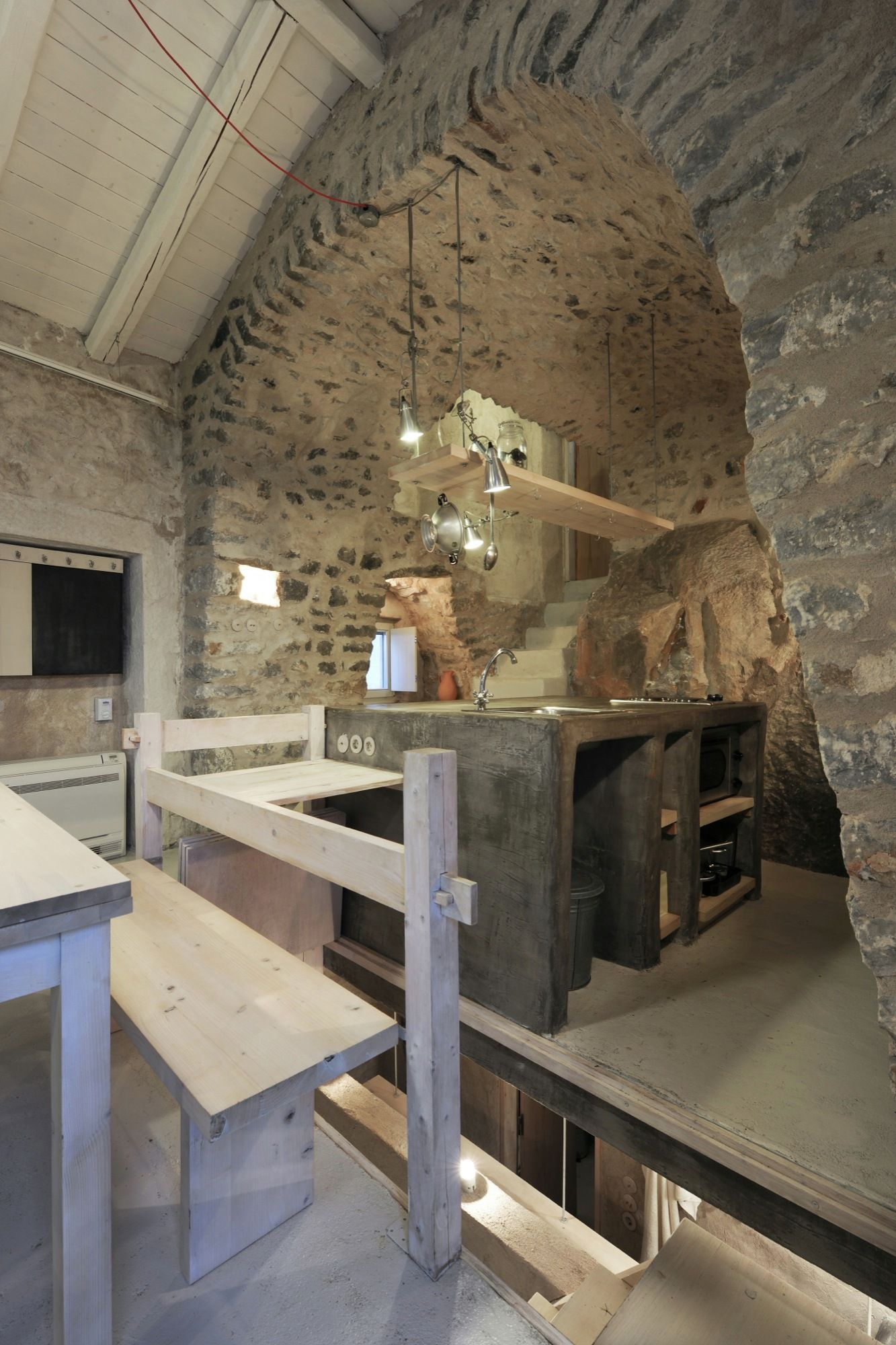 Tower holiday house in Greece stone arch