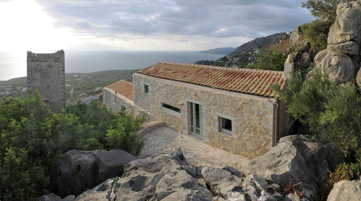 Tower holiday house in Greece tugged landscape