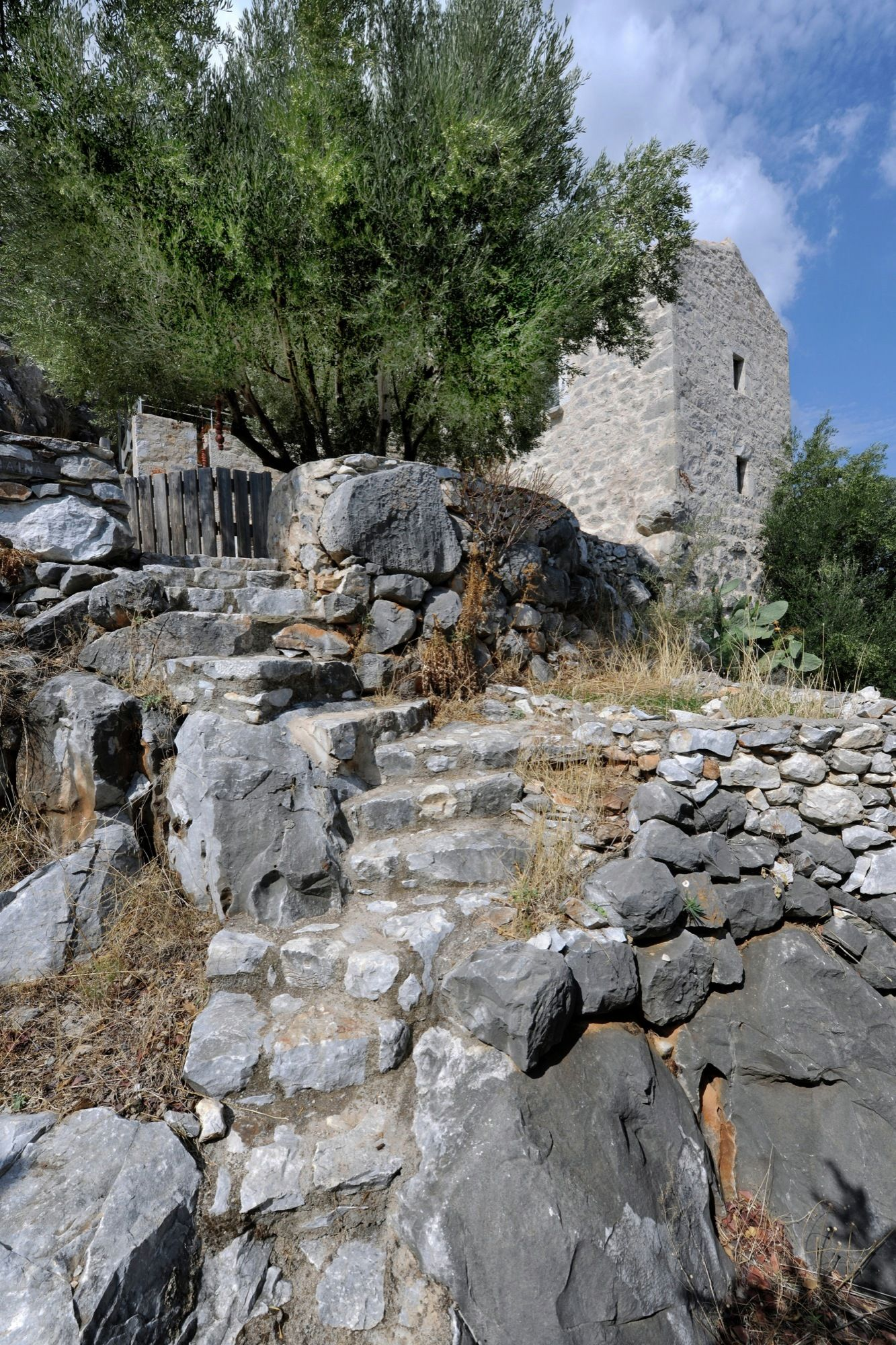 Tower holiday house in Greece waterfall rocks