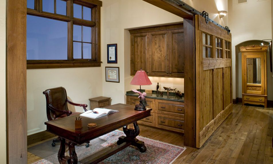 Traditional office divided by a large sliding door
