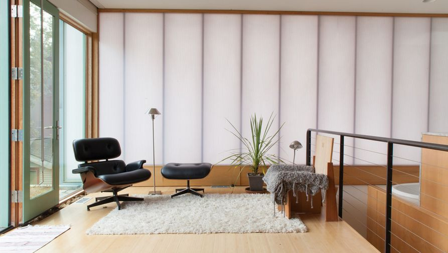 The warmth of the Eames lounge chair is perfect for lending an edge of softness the feel of a minimalist space.