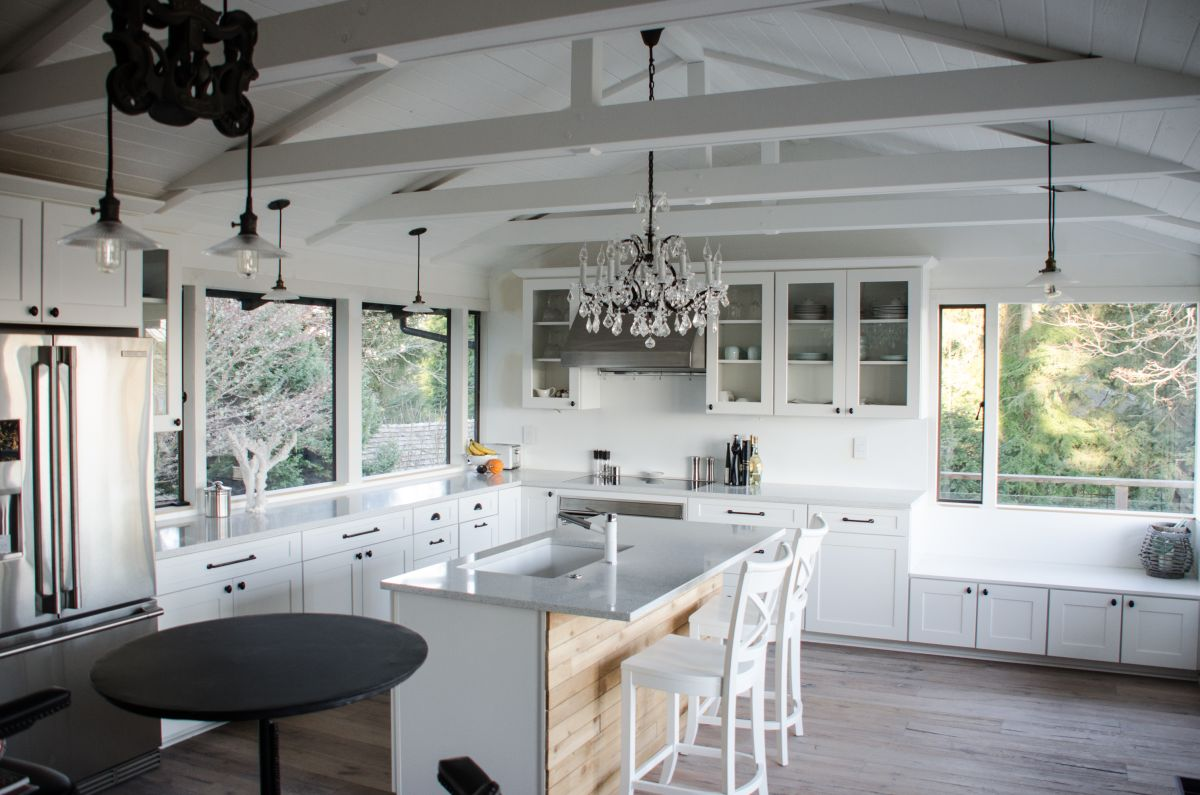 Vaulted ceilings 101 history pros cons and inspirational examples white kitchen with vaulted ceiling aloadofball Image collections