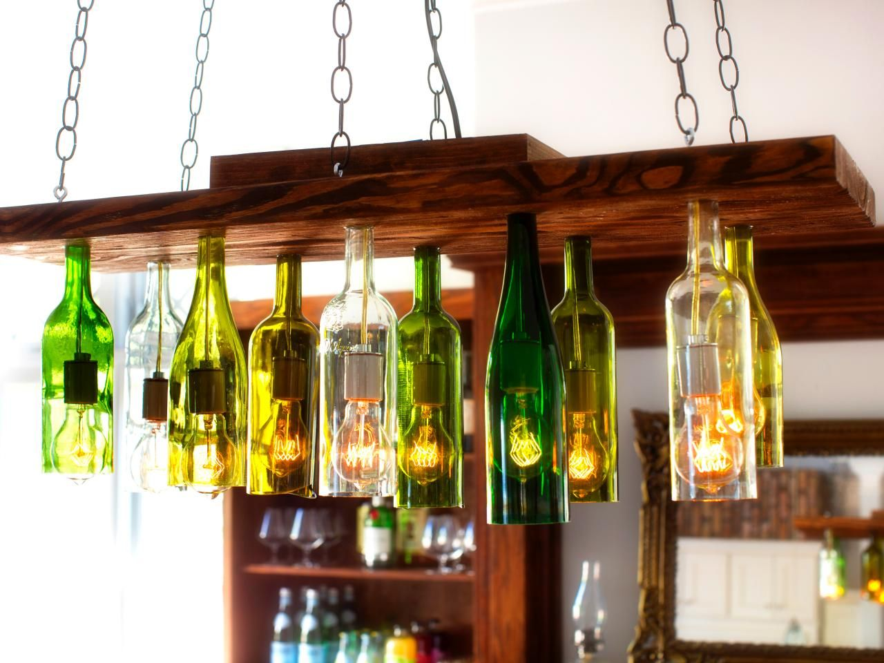 Diy chandeliers that will light up your day chandelier made from upcycled glass bottles solutioingenieria Images