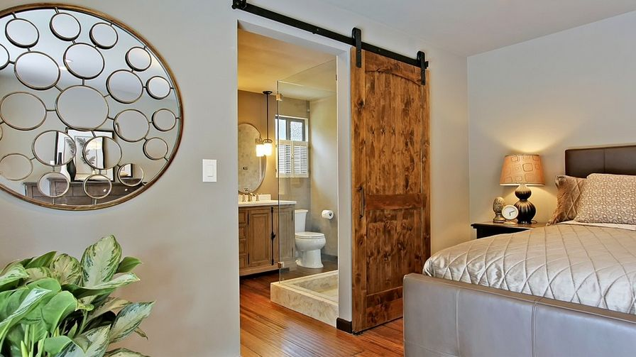 sliding barn door would be a space-efficient option
