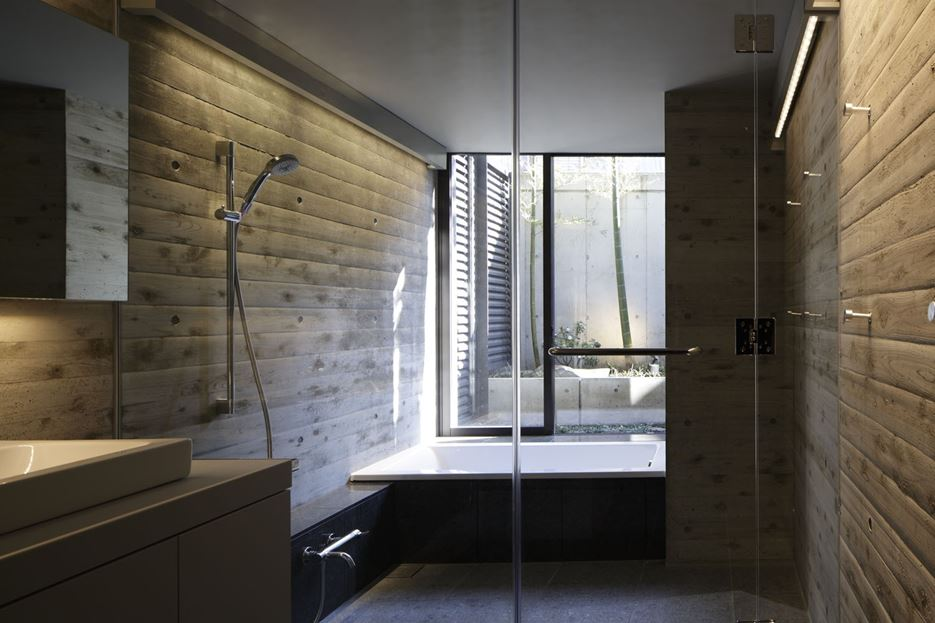 Bathroom shower with wood accents