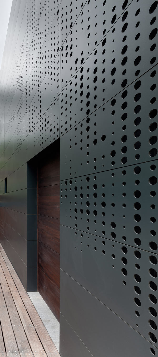 Black casa alta perforated facade closer