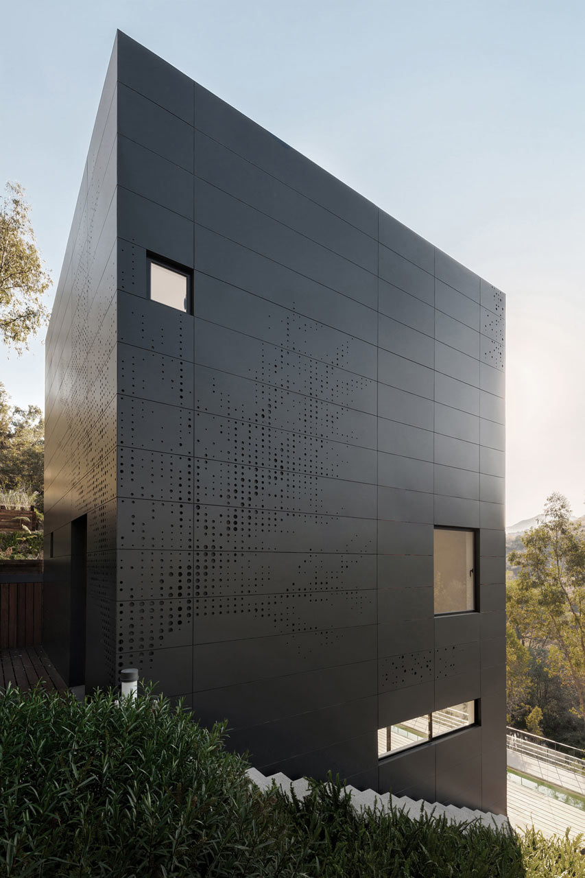 Black casa alta perforated facade