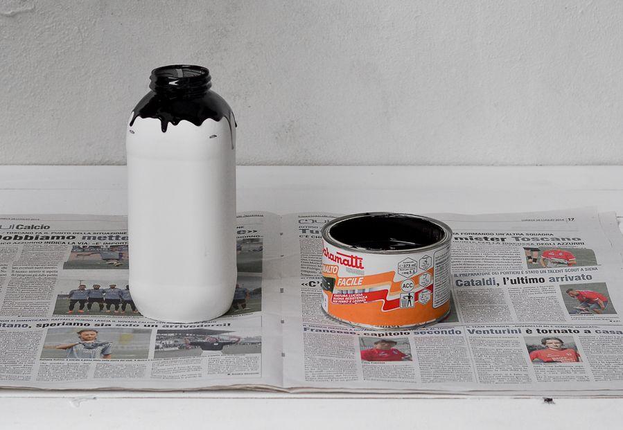 Black paint on the white milk jar