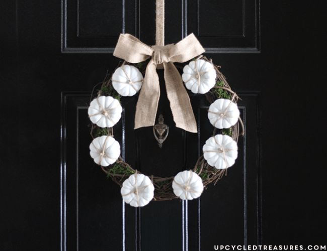 Decorate a grapevine wreath with miniature pumpkins