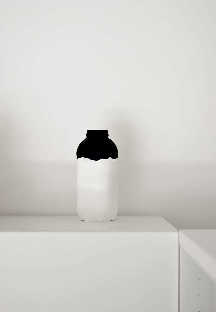 Display the painted halloween jar