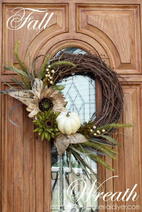 Grapevine wreath decorated with a small pumpkin