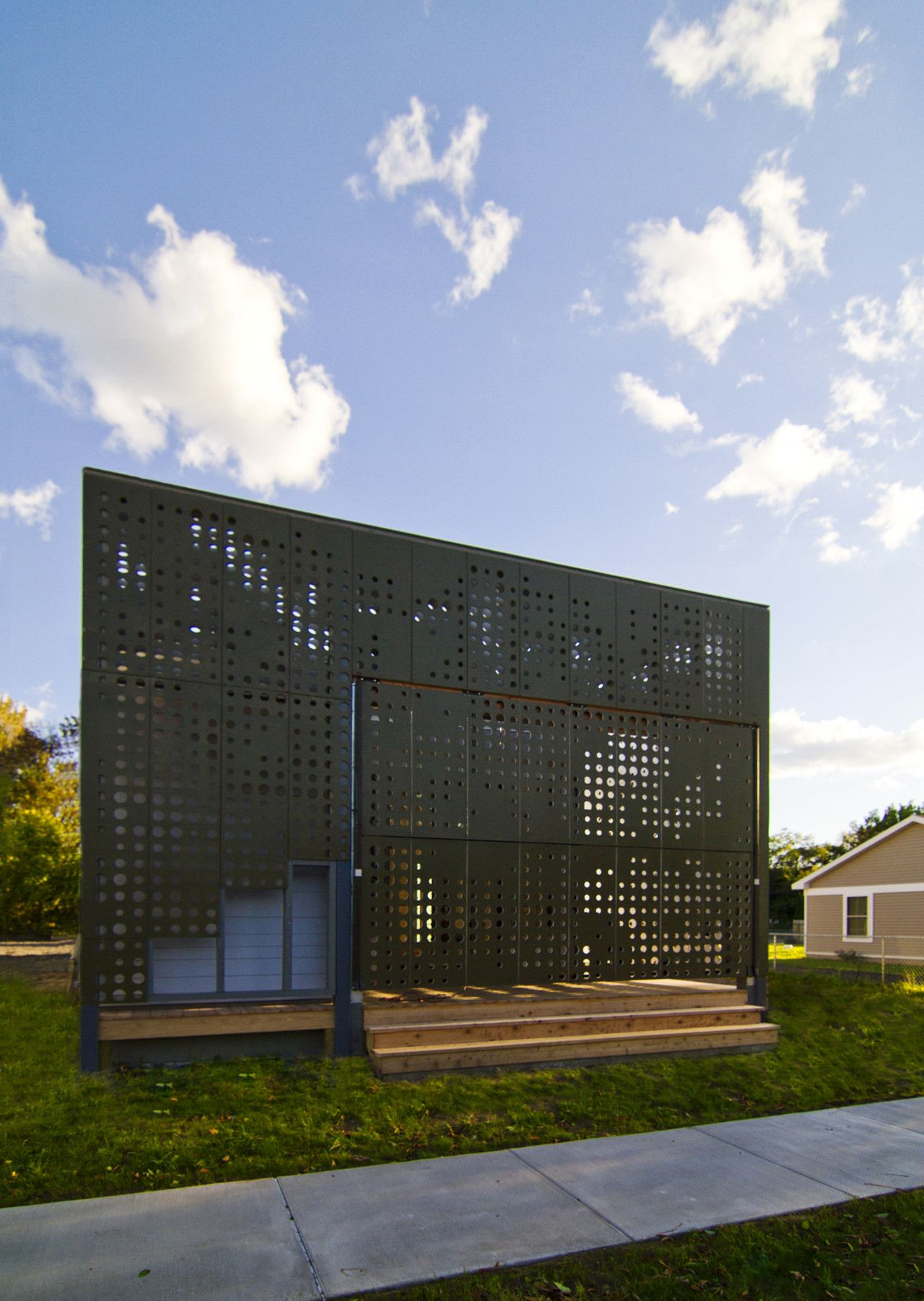 Live Work Home with a perforated Facade