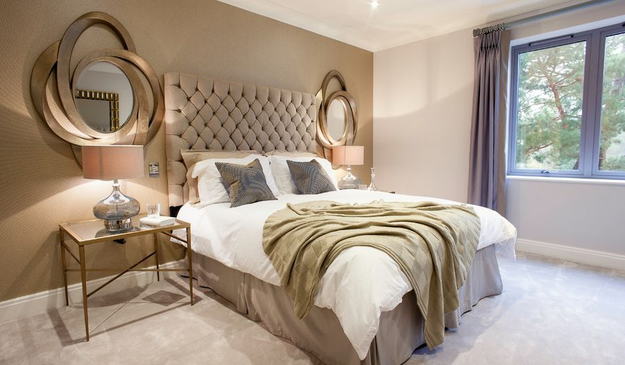 Luxury golden bedroom with tuftead headboard